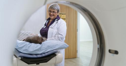 Doctor with patient in an MRI machine