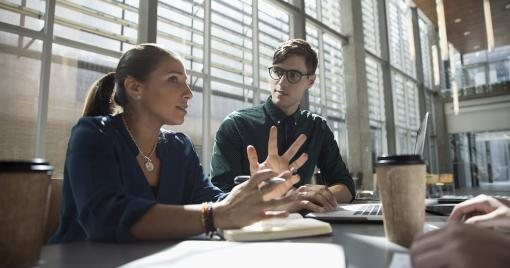 Man and woman in discussion during a meeting