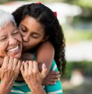 Young woman hugging her grandmother