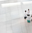 An overhead photo of a group of medical professionals standing in a small circle.