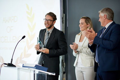 three people at an award ceremony